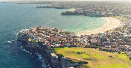 Learn how to surf at Bondi Beach, where the waves are perfect all year