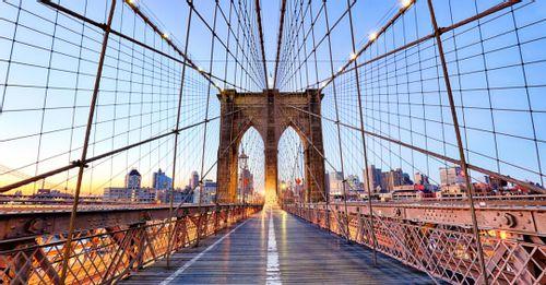 Take a photo at the Brooklyn Bridge