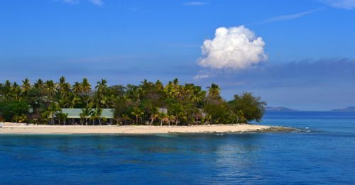 Go surfing at Tavarua Island