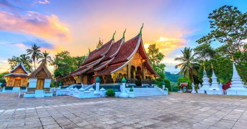Explore Buddhist art inside the Wat Xieng Thong