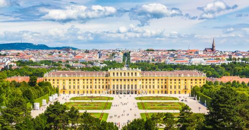 Admire the elaborate garden design at the Schönbrunn Palace while standing at the Gloriette monument