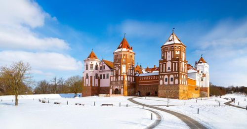 Admire the unique and colorful architecture of the Mir Castle