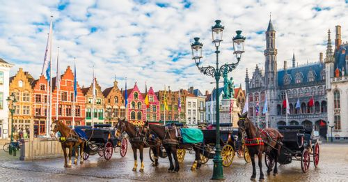 Take photos of the traditional Belgium architecture surrounding the Bruges Market Square