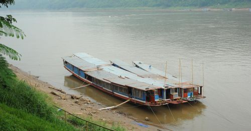 Admire the scenic Laos landscape on a Mekong River Cruise