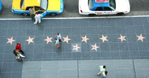 Walk along the Hollywood Walk of Fame