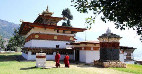 "Enter the Chimi Lhakhang temple to learn about the ""Divine Madman"" and the peculiar art adorning the temple and nearby village"