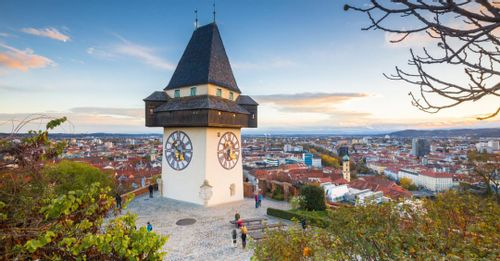 Take the funicular railway to the top of Schlossberg Hill for a panoramic view of Graz