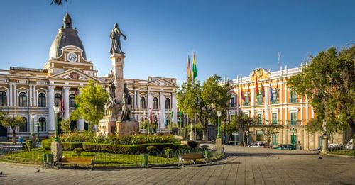 Explore the historical government buildings around Plaza Murilla