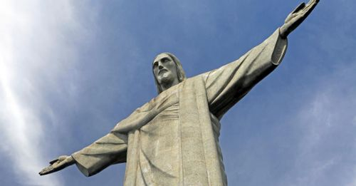 Take a selfie in front of the Christ the Redeemer statue