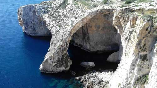 Take a Rowboat through the Blue Grotto