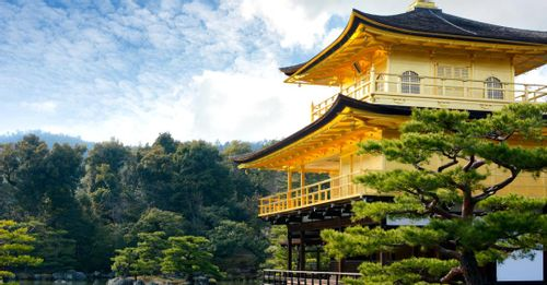 See the reflecting gold rooftops of the Kinkaku-Ji Temple