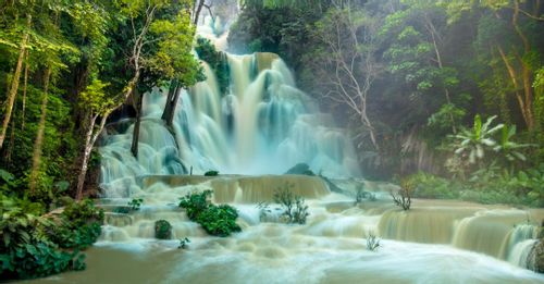 Cool off in the natural pools at the Kuang Si Waterfalls