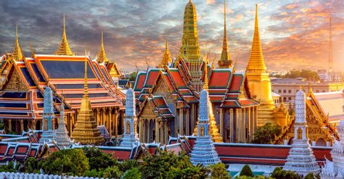 Visit the Temple of the Emerald Buddha inside the Grand Palace