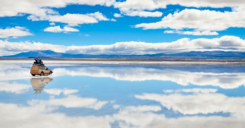 Admire the perfect reflections in the world's largest mirror at the Uyuni Salt Flats