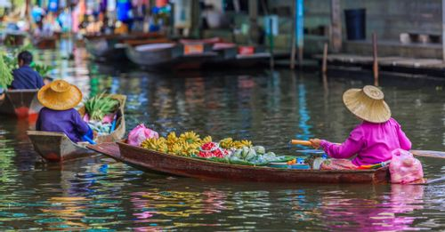 Shop fresh fruit at the Damnoen Saduak Floating Market